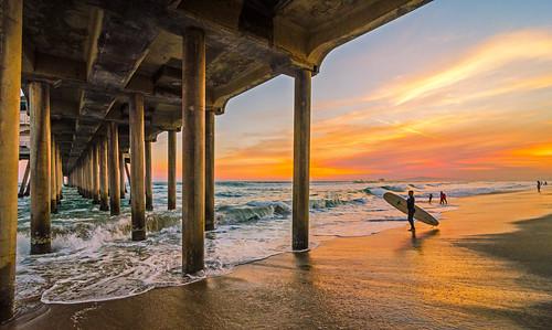ocean california sunset pier nikon waves surfer nike tokina explore surfboard huntingtonbeach hb hurley underthepier explored hbpier d7000 meeyak