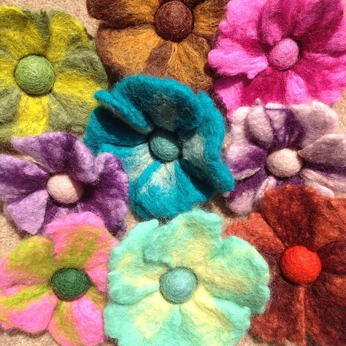 Yesterday's felt flowers, now dry and ready for brooch pins. More enormous flowers for hair combs on their way!