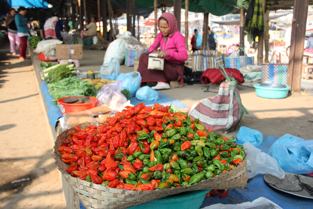 Market vendor selling king chillies