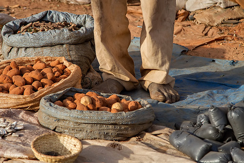 Feet of a man selling traditional medicine in Ouagadougou, Burkina Faso.