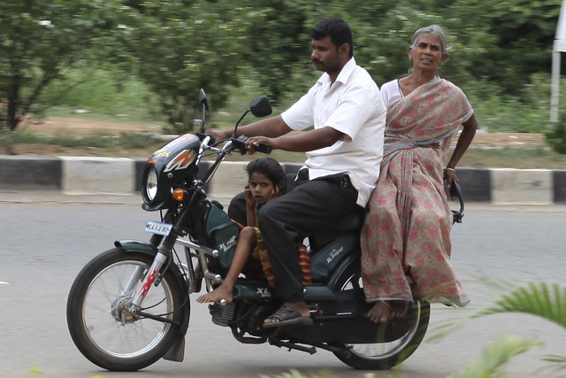 Joint family on a moped