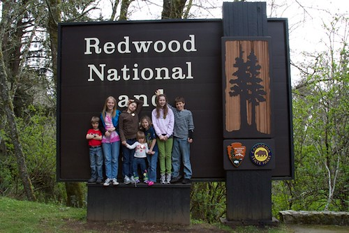 Cousins in front of Redwood National Park Sign