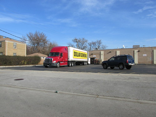 A local Dollar General store receiving a truck shipment.  Chicago Illinois.  November 2013. by Eddie from Chicago