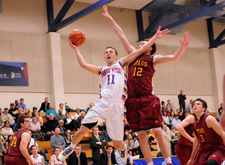 Guard Kyle McAndrews '15 goes to the basket during a game against Claremont-Mudd-Scripps in 2013