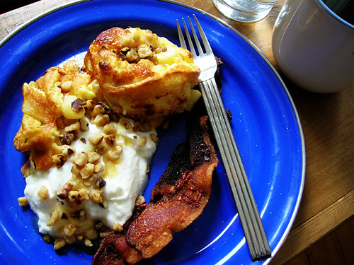 sweet apple clafouti with greek yogurt, toasted walnuts, maple syrup and bacon, with water and coffee