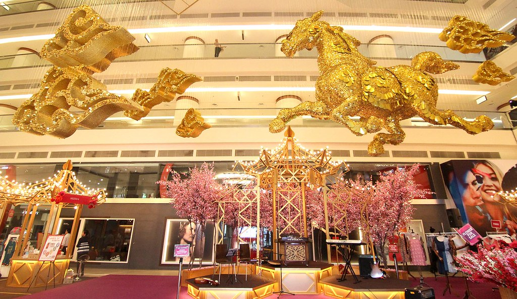 A regal figure of a golden horse erected on the Ground Floor Atrium, Avenue K to usher in the Year of the Horse