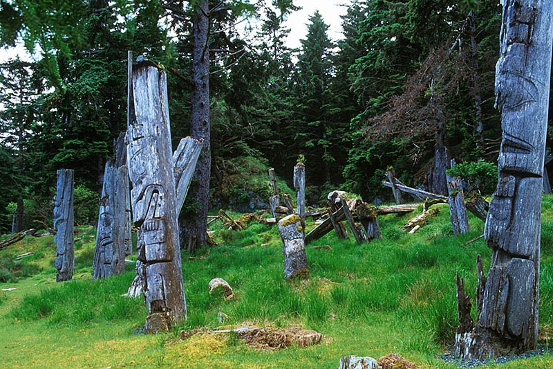 Totem Poles in ancient Nimstints Village on Anthony Island, Haida Gwaii (Queen Charlotte Islands), British Columbia, Canada