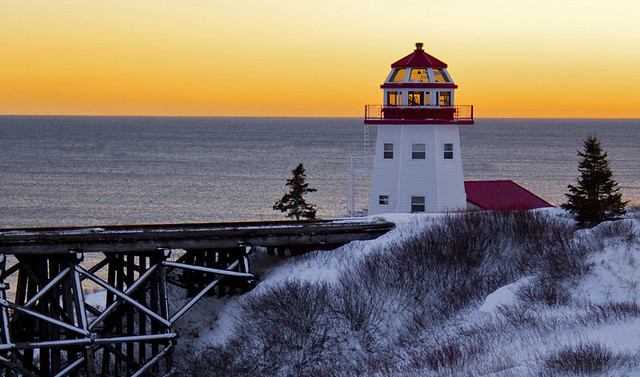 Winter sunset at the Lighthouse. Gaspesie, Canada.