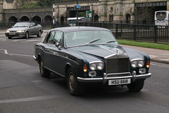 sports car(0.0), automobile(1.0), rolls-royce(1.0), rolls-royce corniche(1.0), rolls-royce camargue(1.0), vehicle(1.0), rolls-royce silver shadow(1.0), rolls-royce corniche(1.0), bentley t-series(1.0), antique car(1.0), sedan(1.0), classic car(1.0), land vehicle(1.0), luxury vehicle(1.0), convertible(1.0),