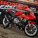 Honda East banner.  Yamaha bike.