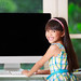 Little asian girl with computer at home