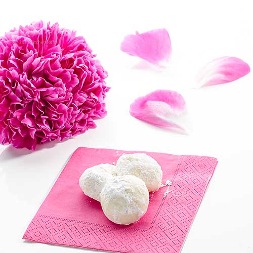 Wedding Cookies on napkin with flower in background