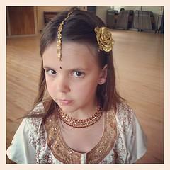 bride(0.0), veil(0.0), bridal veil(0.0), gown(0.0), headgear(0.0), neck(1.0), face(1.0), hairstyle(1.0), brown(1.0), clothing(1.0), head(1.0), jewellery(1.0), hair(1.0), ear(1.0), long hair(1.0), headpiece(1.0),