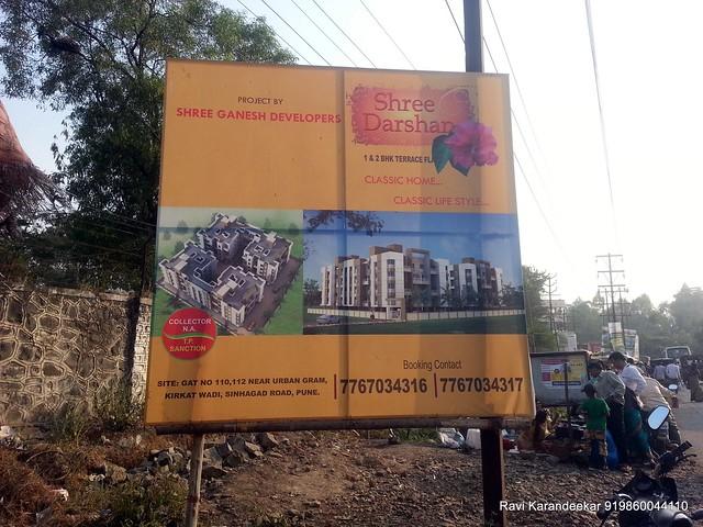 Hoarding of Shree Darshan 1 BHK 2 BHK Flats Kirkatwadi Sinhagad Road Pune 411024 (77670 34316 / 77670 34317) - Visit Belvalkar Kalpak Homes, 1 BHK & 2 BHK Flats at Kirkatwadi, Sinhagad Road, Pune 411024