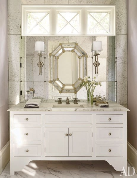 A Bathroom Designed By Suzanne Kasler Interiors Features Beautiful Venetian Mirror Mounted On Wall With An Antiqued