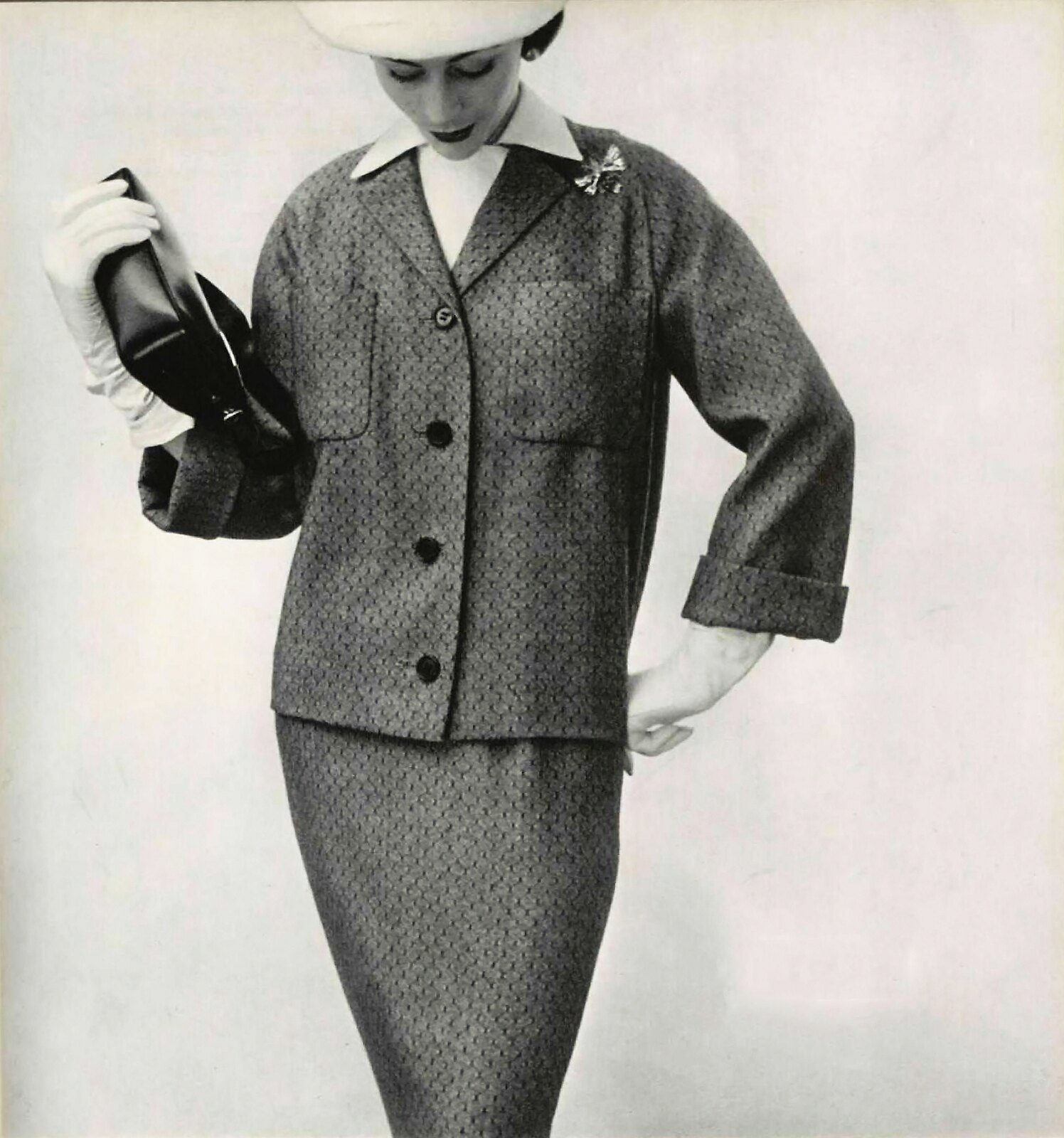 Model in grey and black suit with small straight jacket by Patou ...