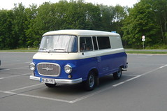 microvan(0.0), compact car(0.0), volkswagen type 2(0.0), antique car(0.0), recreational vehicle(0.0), automobile(1.0), automotive exterior(1.0), van(1.0), commercial vehicle(1.0), vehicle(1.0), minibus(1.0), land vehicle(1.0), luxury vehicle(1.0),