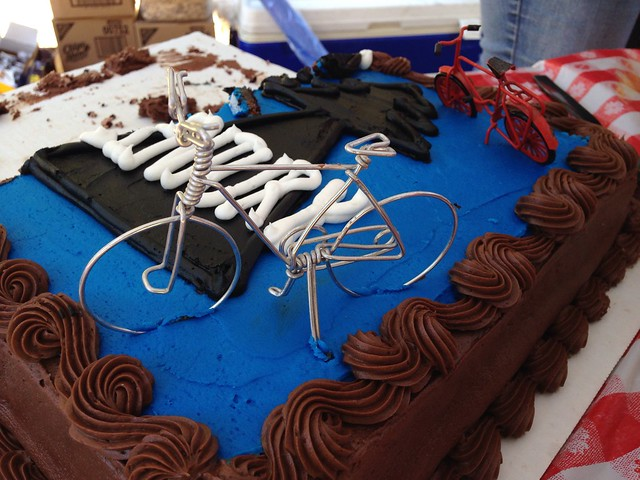 Century cake. Love those bicycle miniatures