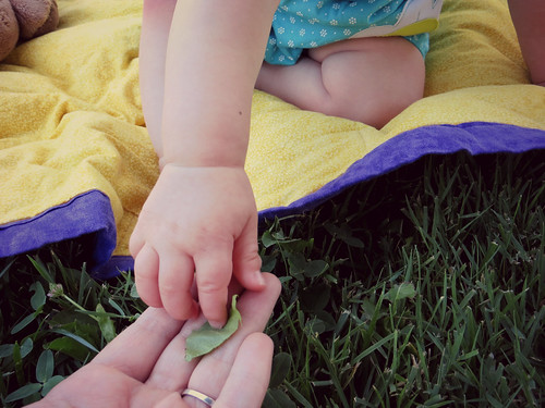 Luna handing her mommy a leaf