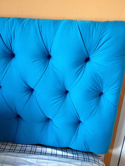 Bright blue DIY tufted headboard