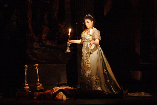 Marco Vratogna as Baron Scarpia and Oksana Dyka as Floria Tosca in Tosca © ROH / Catherine Ashmore 2014