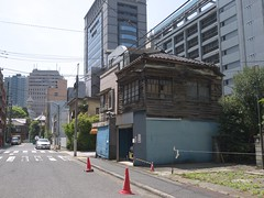 Old houses under skyscrapers