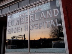 Reflection of sunset on Cumberland Shoe Hospital window