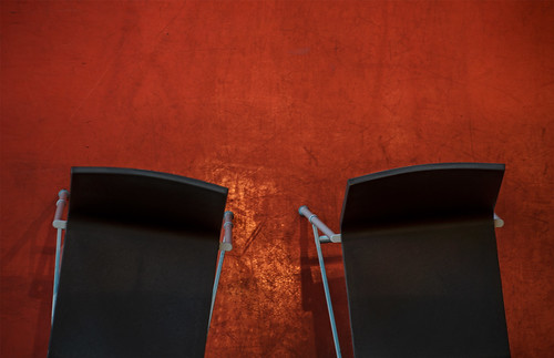 black chairs, orange floor