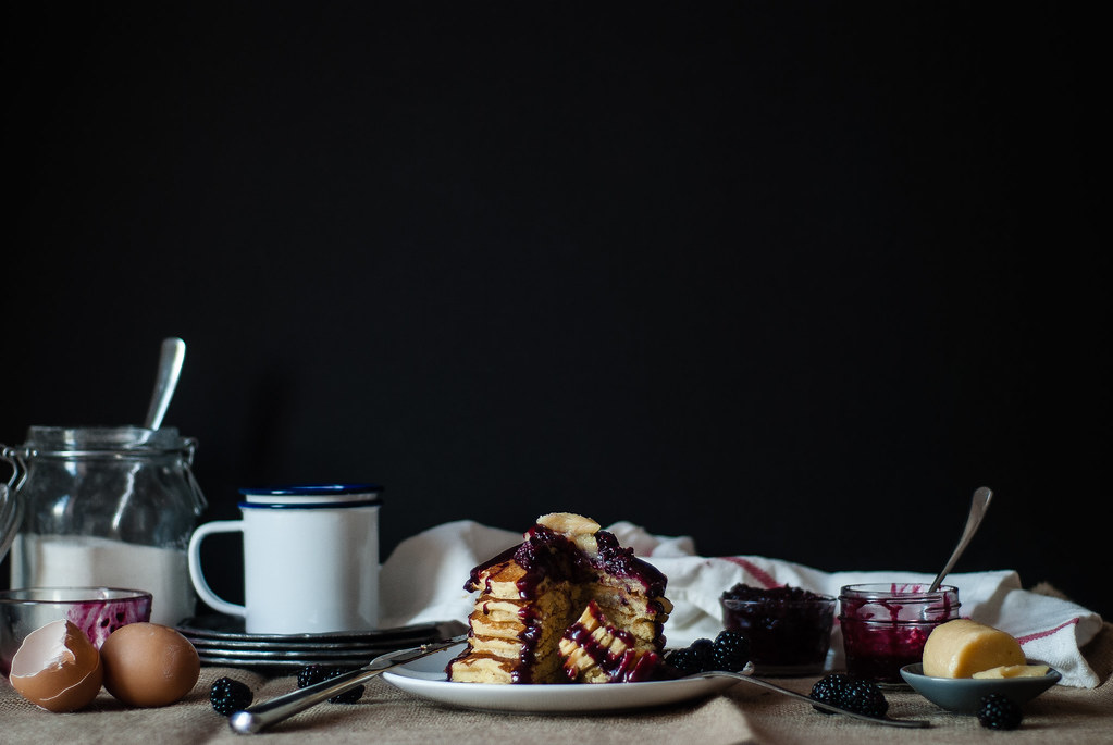 Cornmeal pancakes with blackberry-goat cheese syrup