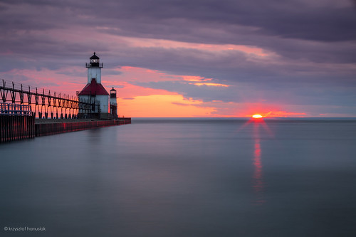 ocean longexposure light sunset red sun lighthouse lake water clouds mi sunrise pier twilight marine colorful glow glare unitedstates michigan horizon smooth stjoseph lakemichigan greatlakes shore maritime catwalk saintjoseph hanusiak