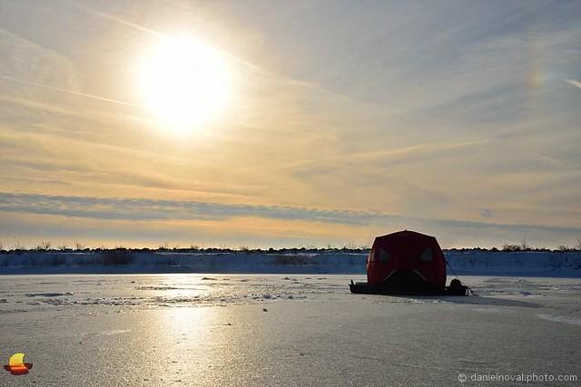 Ice fishing at sunset frozen small boat harbor buffalo for Fishing in buffalo ny