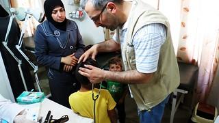 Dr Joesph Homsi of Caritas Lebanon treats Yamen (4) a patient in the clinic in Taalabaya, Bekaa, Lebanon. Credits: Nicholson/Caritas