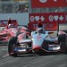 Sebastien Bourdais leads Scott Dixon in the apex of Turn 10 in Toronto