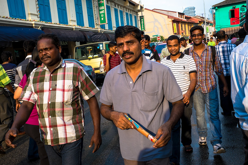 Migrant workers enjoying their day out on a Sunday at Little India.