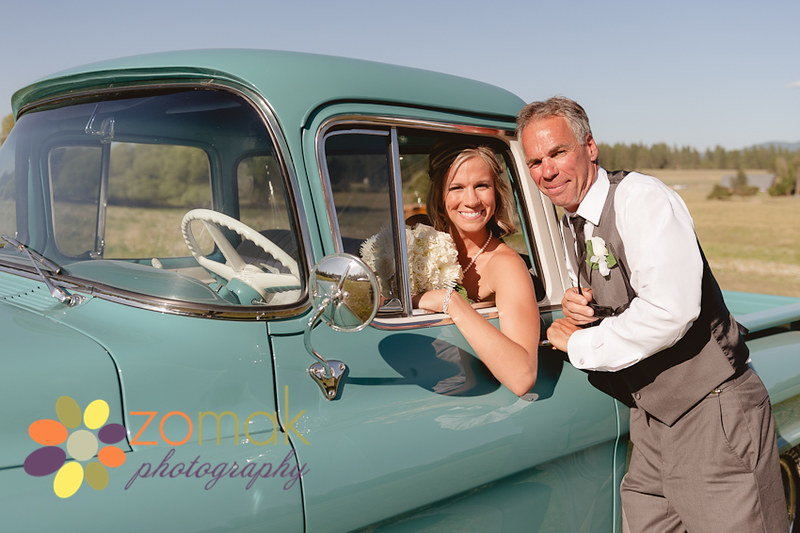 The bride and her dad pose with his antique truck before the ceremony.