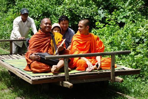 Cambodian monks on the Bamboo Train in Battambang, Cambodia