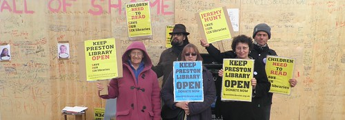 Protesters with placards saying Keep Preston Library open