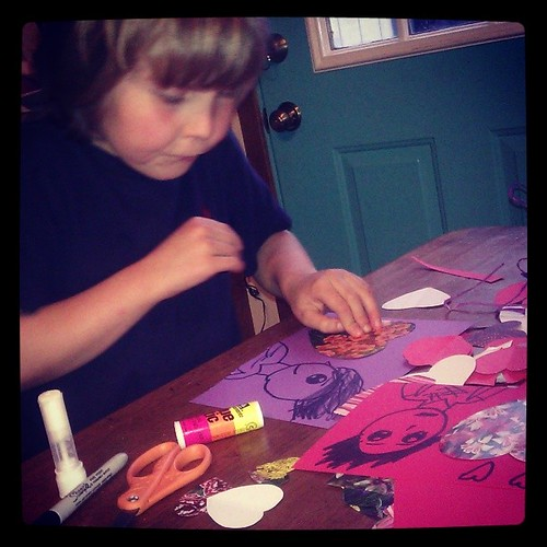 "Expert valentine maker says, ""Don't take my picture. It's in PROGRESS!"" #valentine #son #papercrafts #holiday #homemade #love. #loveinthesuburbs"