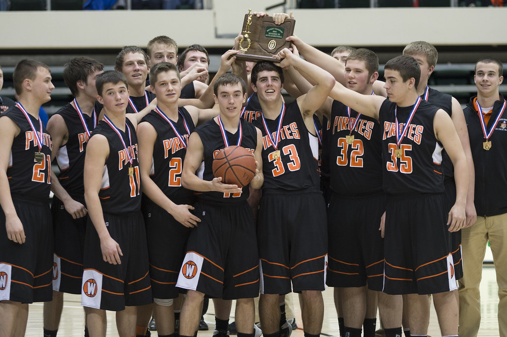 The Pirates hoist their program's 18th district championship trophy.
