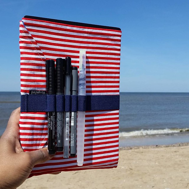 "It's wonderful ""journaling on the beach"" weather! Papelote notebook cover from @bureaudirect is super handy!  #bureaudirect #stationeryaddict #stationerywednesday #journaling #journalonthego #papelote #notebookcover #brushpens #artjournal #lovingkindness"