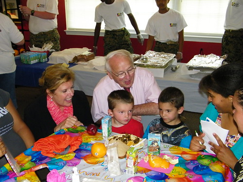 Food and Nutrition Undersecretary Kevin Concannon (kneeling) and RD RBS Administrator, Lillian Salerno (far left) share a funny moment with two young men participating in this year's FNS Summer Feeding Program.