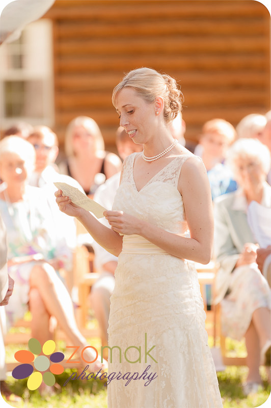 The bride reads her handwritten vows to her groom on their wedding day in montana.