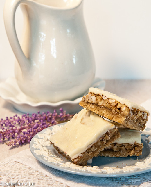 Chewy Coconut Pecan Bars with Browned Butter Icing.