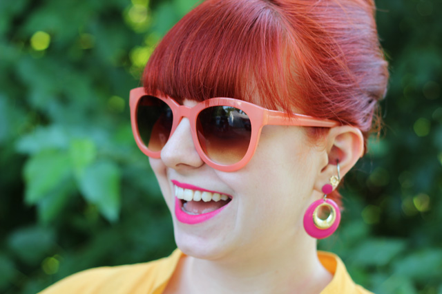 Pink and Gold Earrings, Orange Sunglasses, Bouffant
