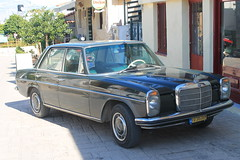 convertible(0.0), automobile(1.0), automotive exterior(1.0), vehicle(1.0), mercedes-benz w108(1.0), mercedes-benz w114(1.0), mercedes-benz(1.0), compact car(1.0), mercedes-benz w111(1.0), antique car(1.0), sedan(1.0), classic car(1.0), vintage car(1.0), land vehicle(1.0), luxury vehicle(1.0),