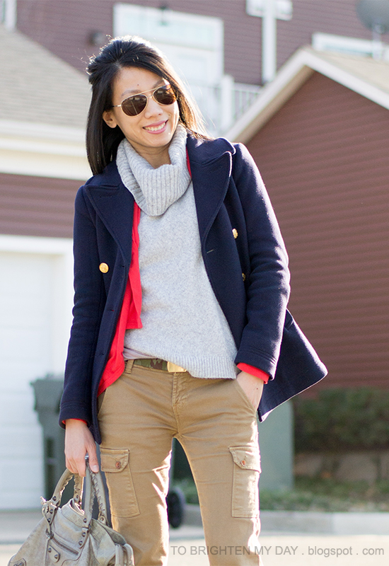 navy peacoat, gray turtleneck sweater, coral drape cardigan, camo belt, cargo pants