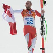 Jan proudly carries the Canadian flag after delivering Canada their first olympic alpine ski racing medal in 20 years