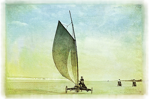 Image from Shorpy Historical Photo Archive showing a sailboat with wheels on the beach