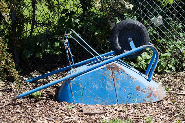 upside-down blue wheelbarrow