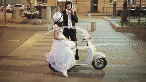 Happy Married Couple On The Scooter